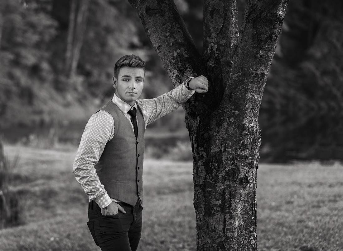 senior against tree